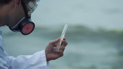 Closeup of researcher examining water pollution, risk of disease and death Live Action