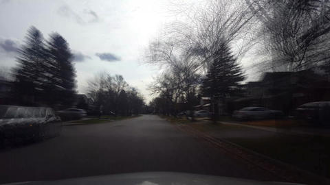 Driving Through Residential Suburban Street in Autumn With Motion Blur Effect Live Action