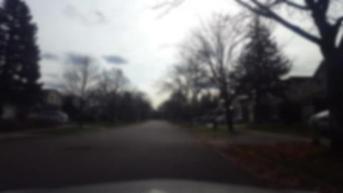 Driving Through Suburban Residential Street in Autumn With Blur Effect Live Action