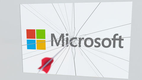 MICROSOFT company logo being cracked by archery arrow. Corporate problems Live Action