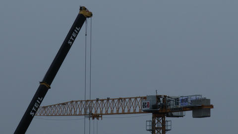 4K Construction Cranes in Work Live Action