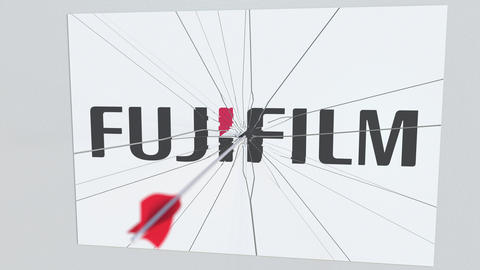 FUJIFILM company logo being hit by archery arrow. Business crisis conceptual Live Action