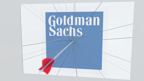 Archery arrow breaks glass plate with GOLDMAN SACHS company logo. Business issue Live Action