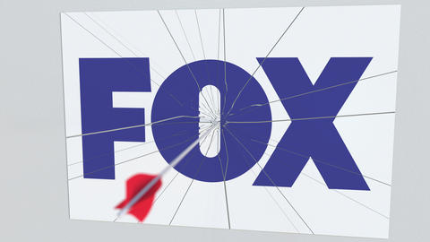 Archery arrow hits plate with FOX logo. Corporate problems conceptual editorial Live Action