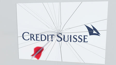 CREDIT SUISSE company logo being cracked by archery arrow. Corporate problems Live Action