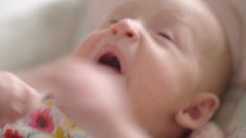 Indoor portrait of two months baby girl with big blue eyes Footage