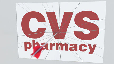 Archery arrow breaks glass plate with CVS PHARMACY company logo. Business issue Live Action