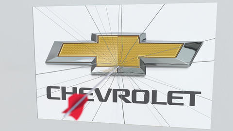 CHEVROLET company logo being hit by archery arrow. Business crisis conceptual Footage