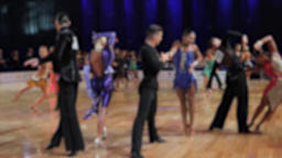 Ballroom dancing. Anonymous defocused people are dancing latin dances Live Action