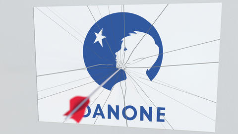 Archery arrow breaks glass plate with DANONE company logo. Business issue Live Action