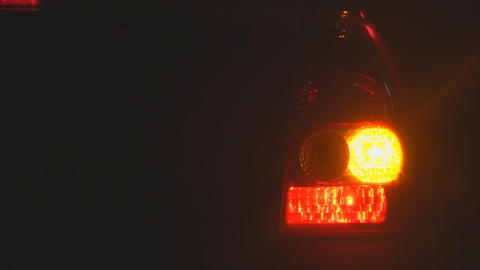 Emergency flashing car rear light lamp at night Footage