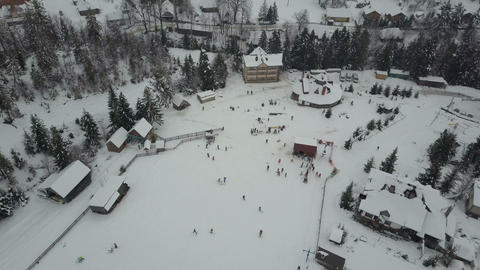 Carpathian ski resort from a height. Flight over ski lifts. Bird's eye view of Footage