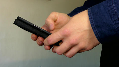 Man Hands Working With A Smartphone Indoors Stock Video Footage