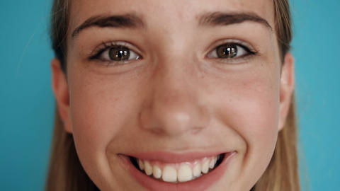Close up of a teen cute girl face. Portrait shot. Close-up face of a beautiful Footage