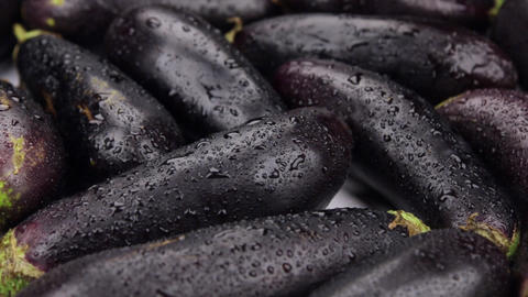 Close-up. The rotation of the background made from eggplant Live Action