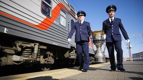 slow motion men in uniform carry winner cup along train ビデオ