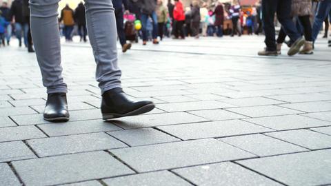 Legs of people slow walking by city street in winter Footage