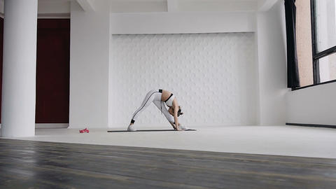 Young woman stretching her legs in yoga standing stretch exercise as part of a Live Action