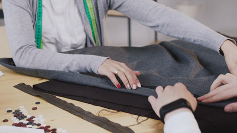 Close-up of a hands of tailored fashion designers working with materials, they Live Action