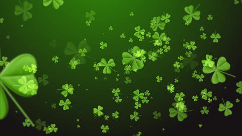 Saint Patrick's Day. Falling clover leaves over dark green background Footage