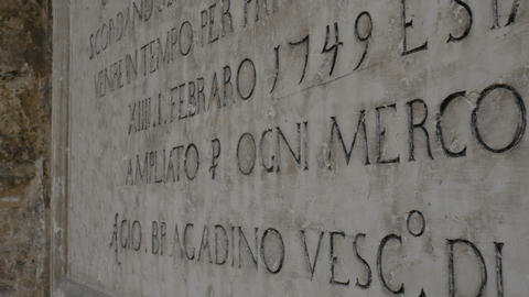 inscription engraved on a marble table in Verona Live Action