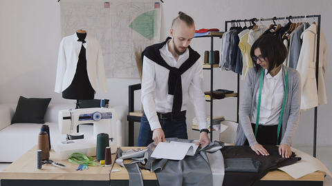 The designer of clothes and dressmaker develops a new collection of clothes at Live Action