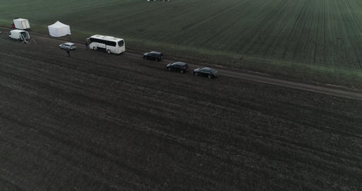 Flying High over a crop Field Movie Crew Setting up a Scene 04 4k at 50fps ビデオ