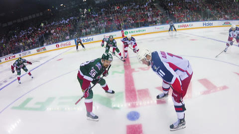 hockey teams begin tense competition for puck on ice Live Action