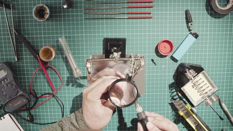 Male hands soldering wire Live Action