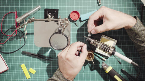 Male hands repairing wire for electronic devices Footage