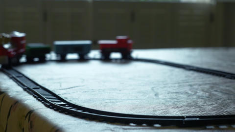 toy train traveling around its track 4k Footage