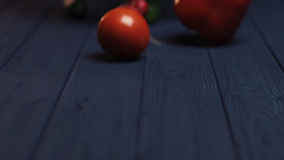 Vegetables Falling on Blue Table Footage