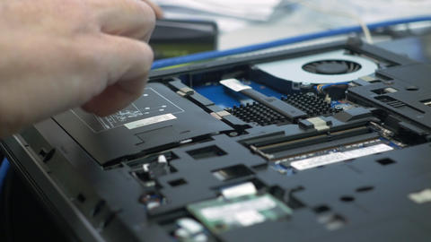 computer tech removing a hard drive from a laptop 4k Footage