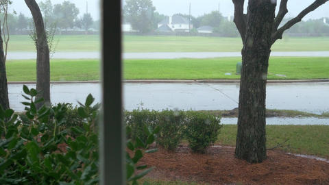 Pan From A Window View Of A Storm Outside Of A Home stock footage