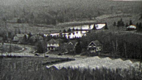 1937: Countryside rural living estate homes in valley below Footage