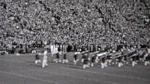 1937: Marching band at football game Minnesota versus Notre Dame football game Footage