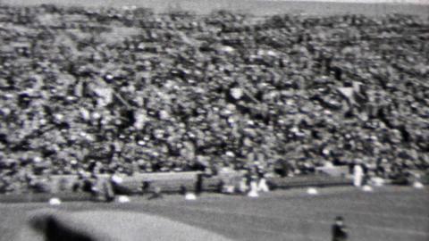 1937: Minnesota versus Notre Dame football pre-game practice lineup Footage