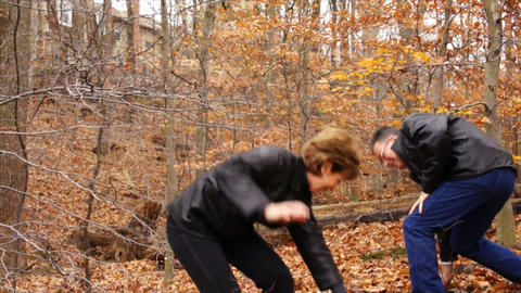 man and woman throwing leaves Live Action