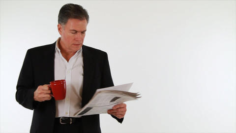 businessman reading newspaper with coffee Footage