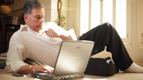 businessman on floor reading laptop Footage
