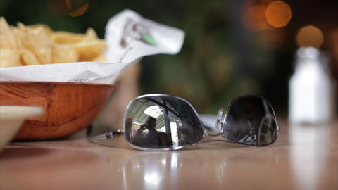 sunglasses reflecting man on cell phone Footage