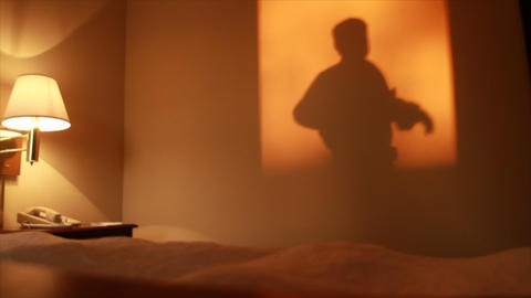 Silhouette Man In Hotel Room stock footage