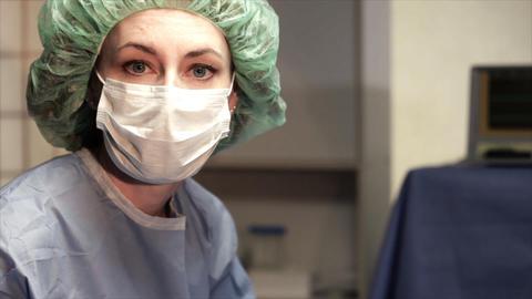 tilt to nurse as she looks at camera Footage