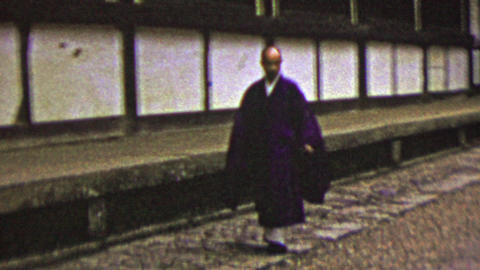 1951: Japanese man traditional robe dress walking alley way street Footage
