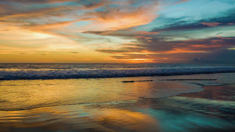 Sunset at ocean with reflections on sand Footage