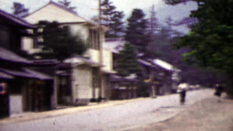 1951: Japanese quiet street woman riding bike in distance Footage