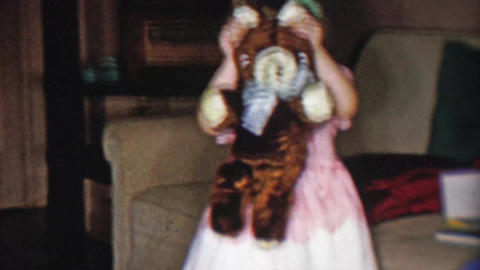 1956: Cute toddler girl hiding behind stuffed animal plush bear toy Footage