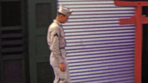 1951: US Military man exiting Army Services Club during R&R trip Footage