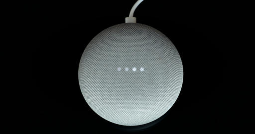 Overhead View Of A Google Home Mini With Cable, Live Action
