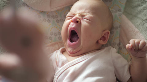 A slow motion of a yawning baby girl Live Action